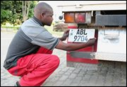 Fitting number plates in Lusaka, Zambia